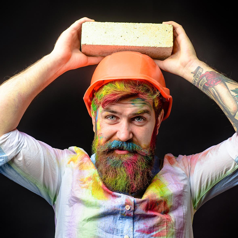 Construction mason worker bricklayer. Man builder bricklayer in orange helmet. Civil engineer. Prevent accident. Safety helmet. Prevent injury. Accident prevention. Safety at any time. Safety concept