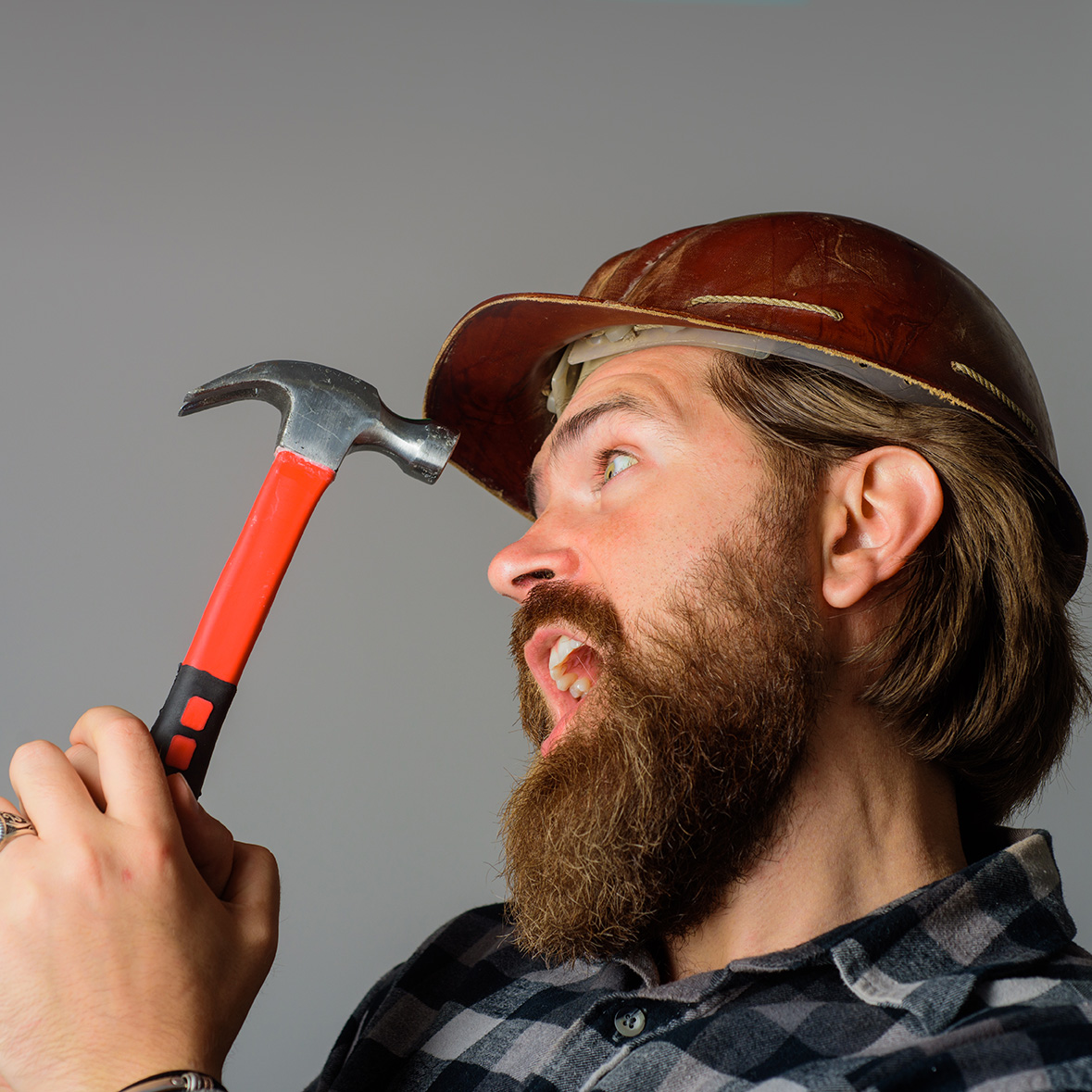 Repairment. Mechanical worker. Worker with hammer. Builder in hardhat. Portrait of bearded workman. Building, industry, technology. Builder in hard hat. Advertise